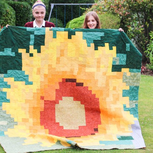 GillyMac Designs Senior Sewing Group with their Sunflower Quilt