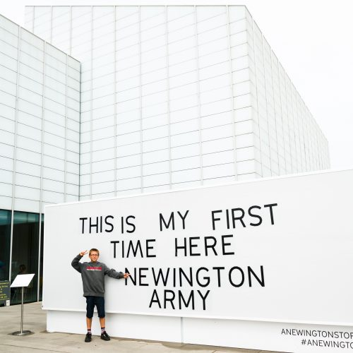 Newington Youth Club member with his message on a giant lightbox outside Turner Contemporary