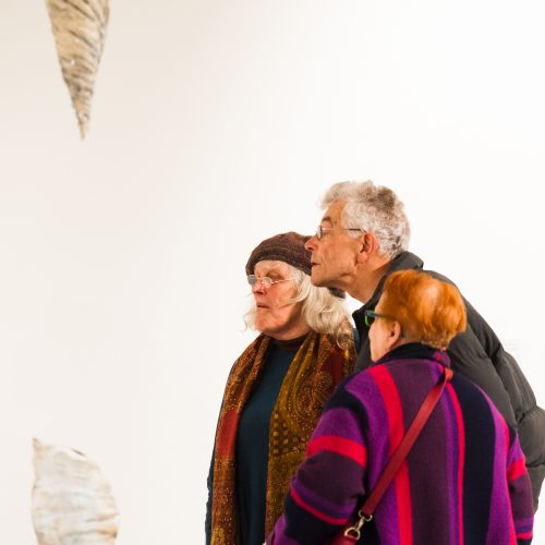 Visitors viewing 'Three Cocoons' at Generation ART: Isle of Wight