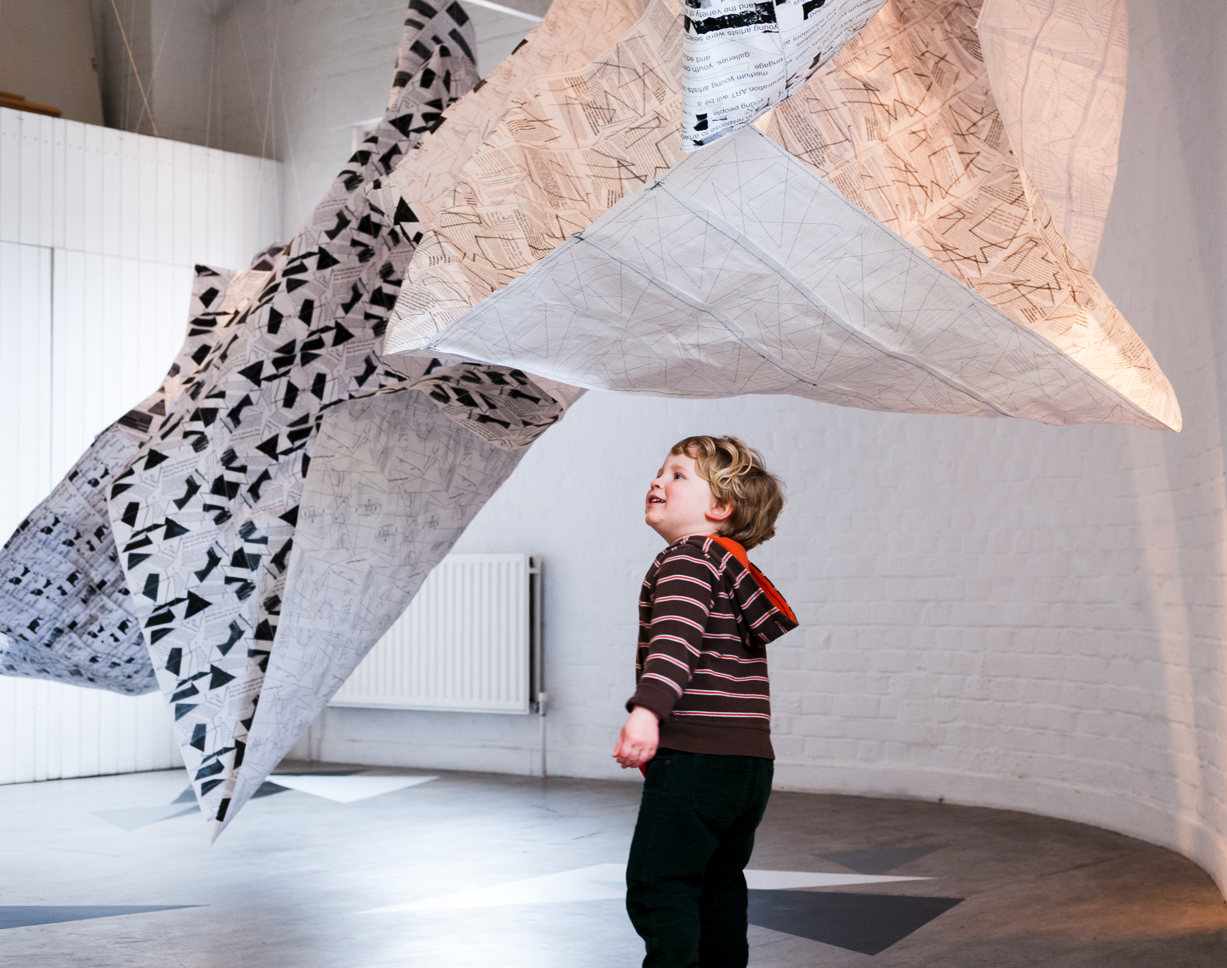 Little boy with 'Cloud Collecting' installation